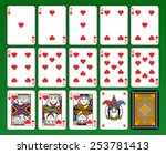 Playing cards, hearts suite, joker and back. Green background. - stock photo