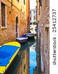 narrow canal with boats in Venice, Italy - stock photo