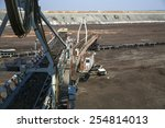 A giant excavator in a coal mine  - stock photo