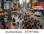 NEW YORK - FEB 27: Pedestrians gather in Times Square on February 27, 2009 in New York City. New Plans to ban vehicle traffic on Broadway from 42nd to 47th Streets are scheduled to begin this May. - stock photo