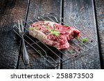 Closeup of beef with rosemary and pepper - stock photo