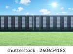 Cloud Computing, Storage Information Concept. Modern Servers Rack on a Beautiful Landscape with Green Grass, Sunshine and Flowing Clouds over Blue Sky - stock photo