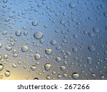 rain drops on the window, sunset in background, stormy clouds behind #4 - stock photo
