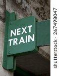 Green Next Train Sign at Railway Station - stock photo