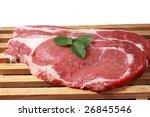 fresh raw beef steak on wood board - stock photo