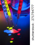 Light Junkie - Glow Stick Juice in Syringes and Shot Glasses - stock photo