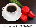 Cup of black coffee on a saucer on the table.  - stock photo