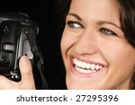 Close-up of Smiling Female Photographer w/SLR - stock photo
