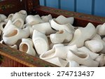 Handmade wooden shoes in a bin waiting to be painted - stock photo