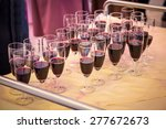 Glasses with red champagne on the party table - stock photo