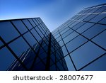 Office building details reflecting blue sky in windows - stock photo