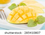 Mango - Hedgehog style cut ripe mango half on a white background. - stock photo