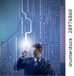 businessman touching a digital motherboard - stock photo