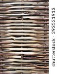 Willow Fence. Section of a fence woven from willow twigs - stock photo