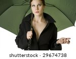 Redheaded Woman in Raincoat with Umbrella. - stock photo