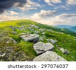 landscape with white sharp boulders on the hillside near mountain peak - stock photo