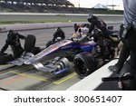 Newton, Iowa USA - July 18, 2015: Verizon IndyCar Series Iowa Corn Indy 300. 25 Justin Wilson Sheffield, England Andretti Autosport Honda. Pit stop action, gets fuel and tires. - stock photo