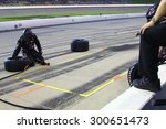 Newton, Iowa USA - July 18, 2015: Verizon IndyCar Series Iowa Corn Indy 300. 25 Justin Wilson Sheffield, England Andretti Autosport Honda. Pit stop, crew prepares with tires, air tool. copy space - stock photo