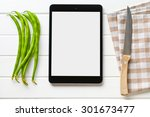 computer tablet with blank screen and green beans - stock photo