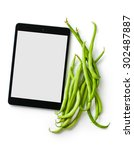 green beans and computer tablet on white background - stock photo