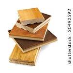Isolated stacked prefinished hardwood flooring samples - stock photo