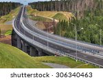 Saint Petersburg, Russia - August 7, 2015: The expressway crosses the forest, steel trestle bridge is supported by reinforced concrete supports. - stock photo
