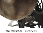 a large gear and a small one on an 1888 printing press, isolated on white - stock photo
