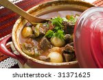 Crock pot of beef goulash, ready to serve.  Lovely warming food. - stock photo
