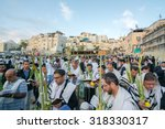 JERUSALEM - OCTOBER 14, 2014: Religious Jews sunrise prayer service at the Western Wall, Kotel, Israel - stock photo
