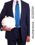 Businessman in suit holding hardhat under arm - isolated on white - stock photo