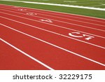 Burgundy track with green grass infield - stock photo