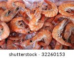 Background of fresh cooked prawns for sale at a market - stock photo