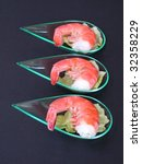 Prawns with salad appetizers on dark gray background - stock photo