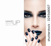 Gorgeous beauty fashion model wearing dark smoky eye makeup with matching dark lipstick and nail lacquer on her manicured nails which are raised to her lips, closeup part face with white card template - stock photo