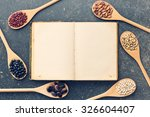 the blank recipe book and various legumes - stock photo