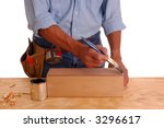 Woodworker applying stain to a wooden box isolated over white - stock photo