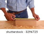 Carpenter measuring small wooden box isolated over white - stock photo