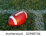Football on sideline - stock photo