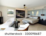Beautiful modern furniture in a master bedroom suite. - stock photo