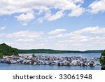 Houseboats lined up at a marina surrounded by beautiful mountains in Kentucky. - stock photo