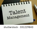 Talent management memo written on a notebook with pen - stock photo