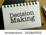 Decision making memo written on a notebook with pen - stock photo