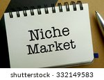Niche market memo written on a notebook with pen - stock photo