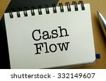 Cash flow memo written on a notebook with pen - stock photo
