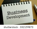 Business development memo written on a notebook with pen - stock photo