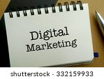 Digital marketing memo written on a notebook with pen - stock photo