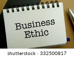 Business ethic memo written on a notebook with pen - stock photo