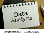 Data analysis memo written on a notebook with pen - stock photo