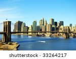 Lower Manhattan and Brooklyn Bridge in New York City - stock photo