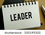 Leader memo written on a notebook with pen - stock photo